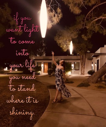 standing under light